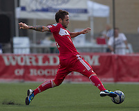 Chicago Fire midfielder Daniel Paladini (11) stretches to trap the ball. In a Third Round U.S. Open Cup match, the Chicago Fire defeated the Rochester Rhinos, 1-0, at Sahlens Stadium on June 28, 2011.