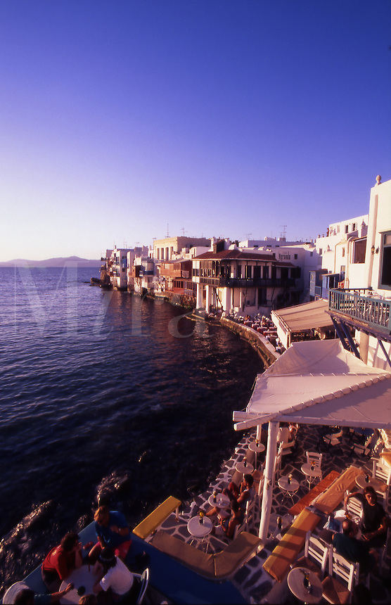 Greece. Mykonos Town. Waterfront restaurants at sunset. Alefkandra Quarter.(Little Venice).