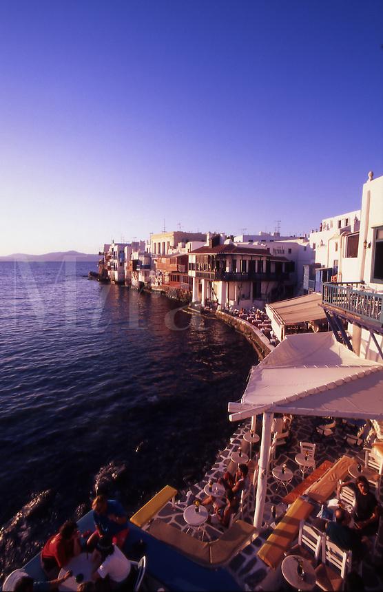 Greece. Mykonos Town. Waterfront restaurants at sunset. Alefkandra Quarter.(Little Venice).