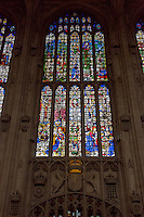 UK, England, Cambridge.  King's College Chapel, 16th. Century Stained Glass Window showing The Nativity, lower right, the Annunciation, lower left, Eve Tempted by the Apple, upper left, Moses and the Burning Bush, upper right.  Symbols of Royal Lineage below window.