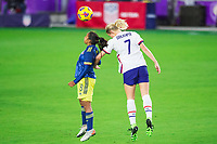 ORLANDO, FL - JANUARY 18: Abby Dahlkemper #7 of the USWNT heads a ball during a game between Colombia and USWNT at Exploria Stadium on January 18, 2021 in Orlando, Florida.