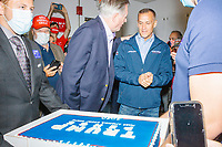 Former 2016 Trump campaign manager and current 2020 Trump campaign senior advisor Corey Lewandowski looks at a birthday cake prepared for him decorated like a 2020 Trump campaign sign as people gather for a Trump campaign office opening party in Salem, New Hampshire, on Fri., Sept. 18, 2020. It was Lewandowski's birthday and he lives in nearby Windham, NH.
