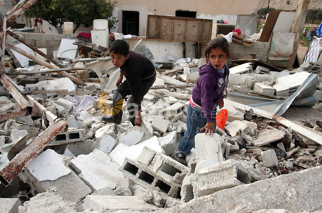 Palestinian Children inspects their hous which was demolished by Israeli army that was built without a construction permit, in bedouin area, village of Jaba, north of Jerusalem on Feb. 27, 2012.  Photo by Issam Rimawi