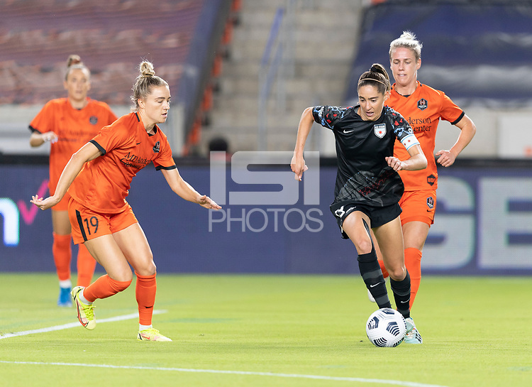 HOUSTON, TX - SEPTEMBER 10: Morgan Gautrat #13 of the Chicago Red Stars brings the ball up the field with Kristie Mewis #19 closing in and Sophie Schmidt #13 of the Houston Dash right behind her during a game between Chicago Red Stars and Houston Dash at BBVA Stadium on September 10, 2021 in Houston, Texas.