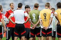 Germany manager Joachim Low talks to his players during training