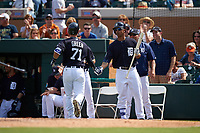 Detroit Tigers Anthony Gose congratulates Austin Green (71) after hitting a home run during an exhibition game against the Florida Southern Moccasins on February 29, 2016 at Joker Marchant Stadium in Lakeland, Florida.  Detroit defeated Florida Southern 7-2.  (Mike Janes/Four Seam Images)