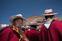 "Musicians accompany the Offertory procession of the Miners Carnival in the descent from the Cerro Rico mountain, for the blessing of their saints in the Cathedral of the city of Potosi, Bolivia. 23 January 2016./ Musicos acompañan la prosecion del carnaval minero en el descenso del Cerro Rico para la bendicion de los santos en la catedral de la ciudad de Potosi, Bolivia. Enero 23 de 2016. The customs and beliefs of Andean people are a hybrid of catholic religion and old beliefs. One of its highest expressions is within the Bolivian mining culture that worships the Pacha Mama (Mother Earth), the Celestial Divinity personified in the Catholic God and ""El Tio"" of the mine (Satan). To the latter, who rules the underworld, they make offerings with sacrifices of llamas inside the mines to ask for protection in the depths of the mountain and abundant mineral."