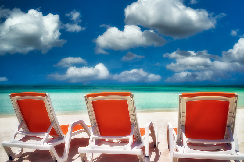 Sapodilla bay with beach chairs. Providenciales. Turks and Caicos