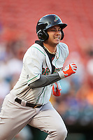 Norfolk Tides right fielder Dariel Alvarez (12) runs to first base during a game against the Buffalo Bisons on July 18, 2016 at Coca-Cola Field in Buffalo, New York.  Norfolk defeated Buffalo 11-8.  (Mike Janes/Four Seam Images)