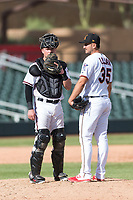 Salt River Rafters catcher Dom Miroglio (55), of the Arizona Diamondbacks organization, visits with relief pitcher Hector Lujan (35), of the Minnesota Twins organization, during an Arizona Fall League game against the Surprise Saguaros at Salt River Fields at Talking Stick on October 23, 2018 in Scottsdale, Arizona. Salt River defeated Surprise 7-5 . (Zachary Lucy/Four Seam Images)