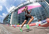 31 JUL 2011 - LONDON, GBR - Nick Beer runs past Building 1000 during the Elite Men's run at the Virgin Active London Triathlon (PHOTO (C) NIGEL FARROW)