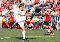 Scott Caldwell #15 of the University of Akron watches his shot score the winning goal during the 2010 College Cup final against the University of Louisville at Harder Stadium, on December 12 2010, in Santa Barbara, California.Akron champions, 1-0.