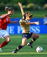 Vicki DiMartino (USA) is pulled back by Alexandra Popp (GER)..FIFA U17 Women's World Cup, Semi Final, Germany v USA, QEII Stadium, Christchurch, New Zealand, Thursday 13 November 2008. Photo: Renee McKay/PHOTOSPORT