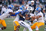 San Jose State defenders, from left, Maurice McKnight (10), Jimmy Pruitt (8) and Frank Ginda (5) tackle Nevada's Hasaan Henderson (12) in an NCAA college football game in Reno, Nev., on Saturday, Nov. 14, 2015. Nevada won 37-34 in overtime. (AP Photo/Cathleen Allison)