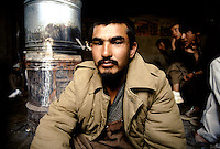 Commander Nasir, a young Hazara Mujahedin Commander in  the Hezb e Wahdat Islami force, of Karim Kalili, in a tea House, in Bamiyan.