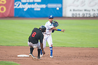 Ogden Raptors second baseman Kenneth Betancourt (9) throws to first base on a double play attempt as Bryce Bush (9) slides into second base during a Pioneer League game against the Great Falls Voyagers at Lindquist Field on August 23, 2018 in Ogden, Utah. The Ogden Raptors defeated the Great Falls Voyagers by a score of 8-7. (Zachary Lucy/Four Seam Images)