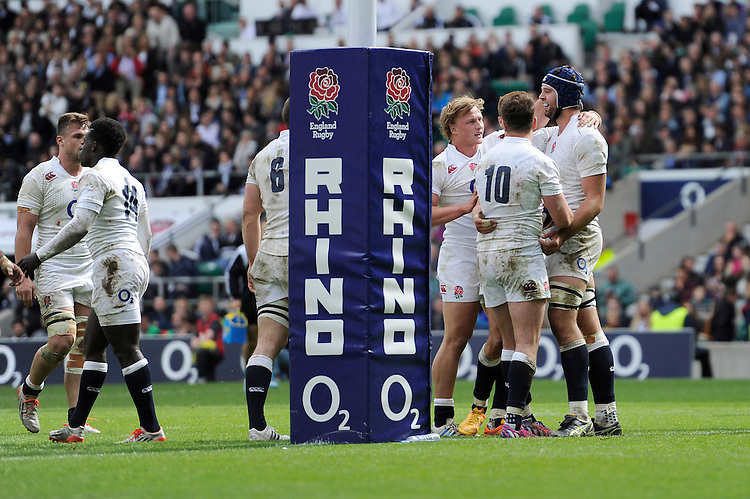 Josh Beaumont of England is congratulated by team mates after scoring a try during the match between England and Barbarians at Twickenham Stadium on Sunday 31st May 2015 (Photo by Rob Munro)