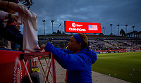 CARSON, CA - FEBRUARY 9: Jessica McDonald #14 of the United States signs autographs during a game between Canada and USWNT at Dignity Health Sports Park on February 9, 2020 in Carson, California.