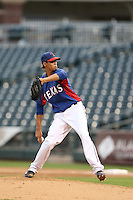 Omarlin Lopez #35 of the AZL Rangers pitches against the AZL Cubs at Surprise Stadium on July 6, 2014 in Surprise, Arizona. AZL Rangers defeated the AZL Cubs, 7-5. (Larry Goren/Four Seam Images)