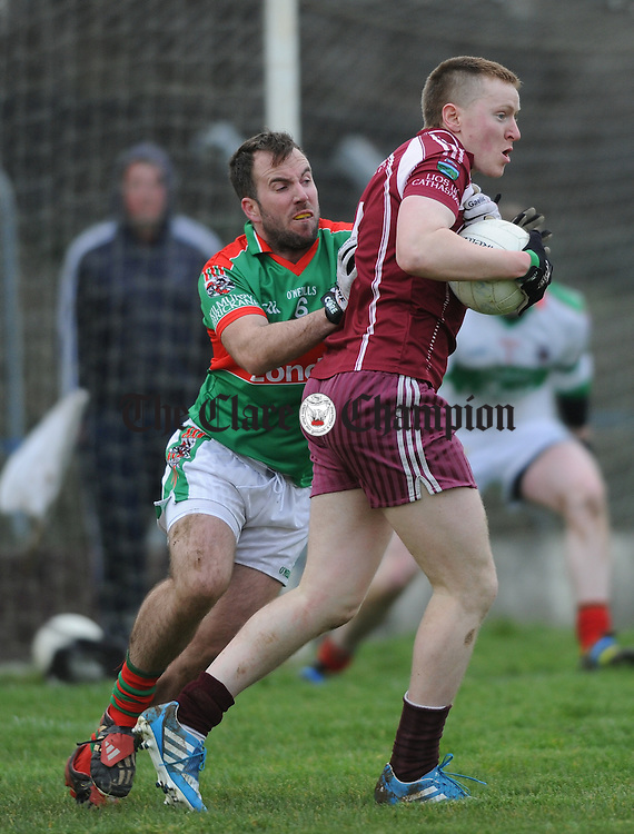 Evan Talty of Kilmurry Ibrickane in action against Francis Hayes of Lissycasey during their Cusack Cup game at Lissycasey. Photograph by John Kelly.