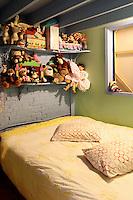 bedroom full of stuffed animals