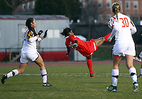 COLLEGE PARK, MARYLAND - April 03, 2013:  Jasmyne Spencer (25) of The Washington Spirit makes an overhead kick against the University of Maryland women's soccer team in a NWSL (National Women's Soccer League) pre season exhibition game at Ludwig Field in College Park Maryland on April 03. Maryland won 2-0.