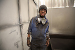 A worker smiles during his journey at a furniture facility in Tlaxcalancingo, in eastern state of Puebla, June 7, 2008. Photo by Heriberto Rodriguez