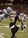 December 2009: Dallas Cowboys cornerback Mike Jenkins (21) deflects a pass intended for New Orleans Saints wide receiver Devery Henderson (19) during an NFL football game at the Louisiana Superdome in New Orleans.  The Cowboys defeated the Saints 24-17.