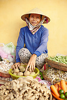 Vietnam, South Central Coast, Hoi An, Fruit and vegetable trader at the food market
