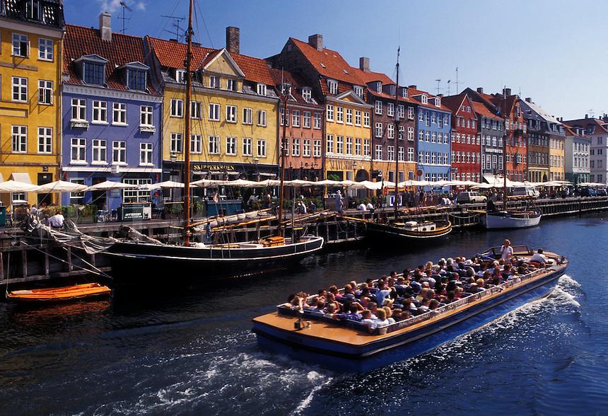 Copenhagen, Denmark, Scandinavia, Sjaelland, canal, Europe, Tour boat cruises Nyhavn (New Harbor) along the scenic city of Copenhagen