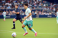 KANSAS CITY, KS - AUGUST 10: Víctor Dávila #7 Club Leon with the ball during a game between Club Leon and Sporting Kansas City at Children's Mercy Park on August 10, 2021 in Kansas City, Kansas.