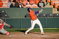 Catcher Adam Hackenberg (17) of the Clemson Tigers bats in a game against the Stony Brook Seawolves on Friday, February 21, 2020, at Doug Kingsmore Stadium in Clemson, South Carolina. The Seawolves catcher is John Tuccillo (45). Clemson won, 2-0. (Tom Priddy/Four Seam Images)