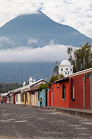 Antigua, Guatemala.  Agua Volcano Towers over the Town.