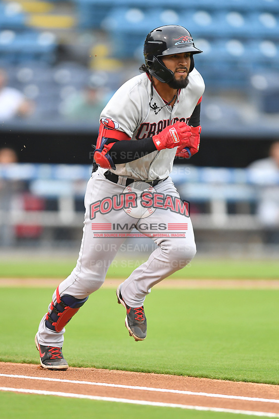 Hickory Crawdads Miguel Aparicio (8) runs to first base during a game against the Asheville Tourists on July 20, 2021 at McCormick Field in Asheville, NC. (Tony Farlow/Four Seam Images)