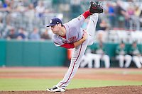 Hagerstown Suns starting pitcher Lucas Giolito (27) follows through on his delivery against the Greensboro Grasshoppers at NewBridge Bank Park on June 21, 2014 in Greensboro, North Carolina.  The Grasshoppers defeated the Suns 8-4. (Brian Westerholt/Four Seam Images)