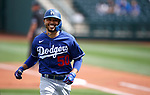 Mookie Betts runs across the field during a spring training game between the Texas Rangers and Los Angeles Dodgers in Surprise, Ariz., on Sunday, March 7, 2021.<br /> Photo by Cathleen Allison