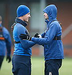 Defensive partners Ross Perry and Emilson Cribari share a handshake and a smile together at training