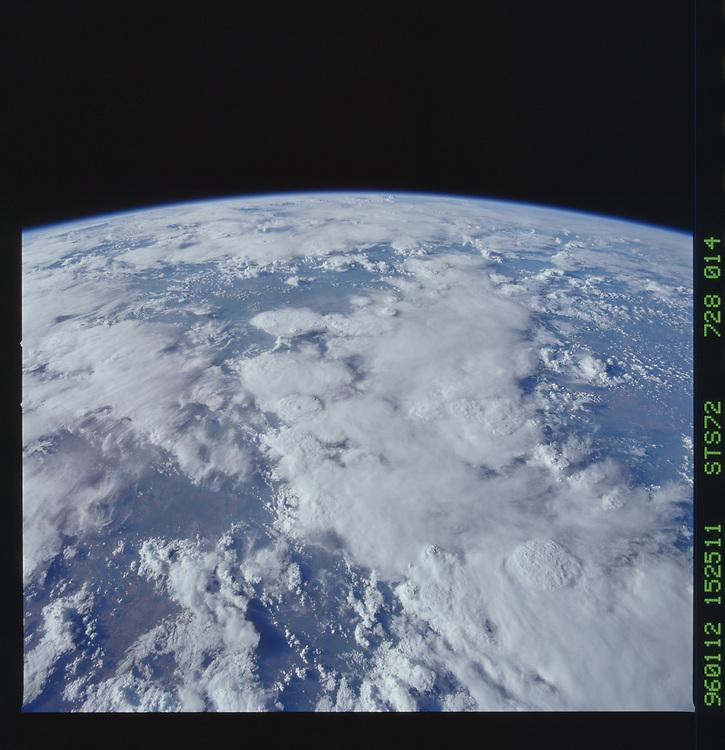 John Angerson. STS-72 Book.<br /> Public Domain Image.<br /> NASA images Courtesy National Archives - Record Group number: 255-STS-STS072<br /> Description: Earth observations taken from shuttle orbiter Endeavour during STS-72 mission.<br /> <br /> Subject Terms: STS-72, ENDEAVOUR (ORBITER), EARTH OBSERVATIONS (FROM SPACE), EARTH LIMB<br /> <br /> Date Taken: 1/12/1996<br /> <br /> Categories: Earth Observations<br /> <br /> Interior_Exterior: Exterior<br /> <br /> Ground_Orbit: On-orbit<br /> <br /> Original: Film - 70MM CT<br /> <br /> Preservation File Format: TIFF<br /> <br /> geon: AFRICA<br /> <br /> feat: PAN-DRAINAGE, CLOUDS<br /> <br /> tilt: High Oblique<br /> <br /> cldp: 80<br /> <br /> nlat: -27.7<br /> <br /> nlon: 27.6<br /> <br /> azi: 256<br /> <br /> alt: 251<br /> <br /> elev: 21