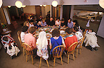 Families and staff  share a meal. Martin House Hospice provides family-led care and support for children and young people with life-limiting conditions. 1990s UK