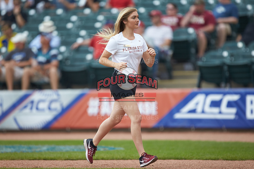 Florida State Seminoles bat girl Breanna Henry jogs back to the dugout during the game against the Duke Blue Devils in the first semifinal of the 2017 ACC Baseball Championship at Louisville Slugger Field on May 27, 2017 in Louisville, Kentucky. The Seminoles defeated the Blue Devils 5-1. (Brian Westerholt/Four Seam Images)