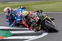 28th August 2021; Silverstone Circuit, Silverstone, Northamptonshire, England; MotoGP British Grand Prix, Qualifying Day; Aprilia Racing Team Gresini rider Aleix Espargaro on his Aprilia RS-GP and Team Suzuki Ecstar rider Alex Rins on his Suzuki GSX-RR