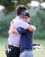 Mako Thompson embraces friend James Hydes after losing his semi final match v Charlie Smail during the New Zealand Amateur Golf Championship, Poverty Bay Golf Course, Awapuni Links, Gisborne, Saturday 24 October 2020. Photo: Simon Watts/www.bwmedia.co.nz