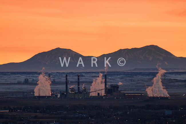 Distance view of Comanche Power Plant at sunset