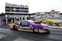 Aug. 19, 2011; Brainerd, MN, USA: NHRA pro stock driver Vincent Nobile (near) races alongside Rodger Brogdon during qualifying for the Lucas Oil Nationals at Brainerd International Raceway. Mandatory Credit: Mark J. Rebilas-