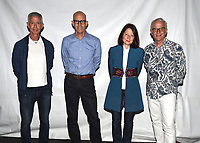 """PASADENA, CA - SEPT 9: (L-R) Aids activist Peter Staley, moderator John Horn, Directors Janet Tobias and John Hoffman attend a drive-in screening of National Geographic Documentary Films """"Fauci"""" at the Rose Bowl on September 9, 2021 in Pasadena, California. (Photo by Frank Micelotta/National Geographic/PictureGroup)"""