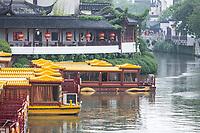 Nanjing, Jiangsu, China.  Tourist Boats on the Qinhuai River in the Rain, Confucius Temple Area.