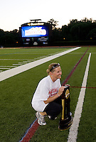 Maryland head coach Cathy Reese poses with the trophy after the NCAA Championship held in Johnny Unitas Stadium at Towson University in Towson, MD.  Maryland defeated Northwestern, 13-11, to win the title.