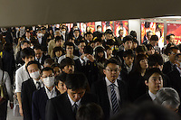 Businessmen in an underground passage in Shinjuku Station, Tokyo, Japan during morning rush-hour. With up to 4 million passengers passing through it every day, Shinjuku station, Tokyo, Japan, is the busiest train station in the world. The station was used by an average of 3.64 million people per day.  That's 1.3 billion a year.  Or a fifth of humanity. Shinjuku has 36 platforms, and connects 12 different subway and railway lines.  Morning rush hour is pandemonium with all trains 200% full. <br /> <br /> Photo by Richard jones / sinopix