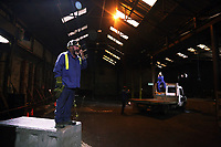 "Pictured L-R: Actors Sion Tudor Owen who plays Mark and Jason May who plays Rob<br /> Re: Press rehearsal of ""We'Re Still Here"", a play created by Rachel Trezise, Common Wealth and the National Theatre Wales about steelworkers, which will be performed in Byass Works, a disused industrial unit, in Port Talbot, south Wales, UK."