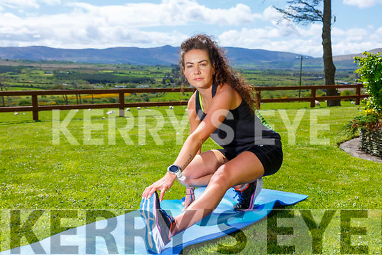 Grace Lynch still keeping fit during Covid Times, stretches and 5K runs within her 2K radius.